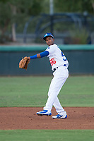 AZL Dodgers shortstop Albert Suarez (56) prepares to make a throw to first base during an Arizona League game against the AZL White Sox at Camelback Ranch on July 3, 2018 in Glendale, Arizona. The AZL Dodgers defeated the AZL White Sox by a score of 10-5. (Zachary Lucy/Four Seam Images)