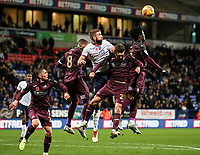Bolton Wanderers' Mark Beevers competing in the air with Swansea City's Wilfried Bony and Matt Grimes<br /> <br /> Photographer Andrew Kearns/CameraSport<br /> <br /> The EFL Sky Bet Championship - Bolton Wanderers v Swansea City - Saturday 10th November 2018 - University of Bolton Stadium - Bolton<br /> <br /> World Copyright © 2018 CameraSport. All rights reserved. 43 Linden Ave. Countesthorpe. Leicester. England. LE8 5PG - Tel: +44 (0) 116 277 4147 - admin@camerasport.com - www.camerasport.com