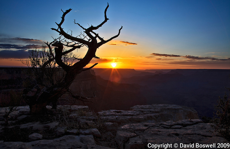 The sun provides a brilliant show as it sets over the Grand Canyon.  Photographed from Yaki Point on the South Rim.