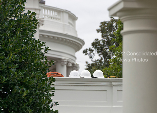 Construction helmets on the roof of the White House West Wing looking towards the South Portico in Washington, DC as it is undergoing renovations while United States President Donald J. Trump is vacationing in Bedminster, New Jersey on Friday, August 11, 2017.<br /> Credit: Ron Sachs / CNP