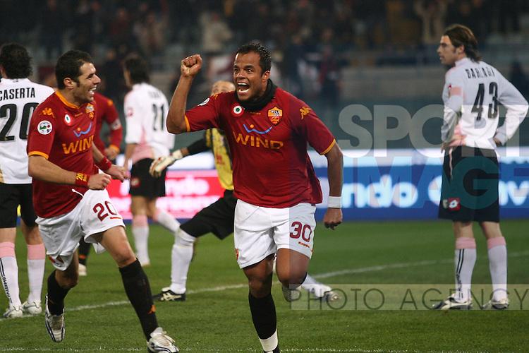 Mancini of Roma celebrates scoring
