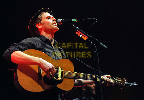 Vocalist/guitarist WESLEY SHULTZ for the American folk rock band THE LUMINEERS performs to a Sold Out concert at a stop on their U.S. tour held at the Stage AE, Pittsburgh, PA., USA..February 5th, 2013.on stage in concert live gig performance performing music half length black shirt guitar singing side profile hat.CAP/ADM/JN.©Jason L Nelson/AdMedia/Capital Pictures.