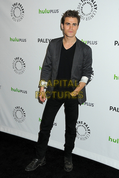 "Paul Wesley.PaleyFest 2012 Presents ""The Vampire Diaries"" held at the Saban Theatre. Beverly Hills, California, USA, .10th March 2012.full length jacket blazer trousers hand in pocket  grey gray black v-neck .CAP/ADM/BP.©Byron Purvis/AdMedia/Capital Pictures."