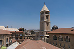 The bell tower of the Luthern Church of the Redeemer and the gray dome of the Sisters of Zion Convent in the Christian Quarter of the Old City of Jerusalem.  The Old City of Jerusalem and its Walls is a UNESCO World Heritage Site