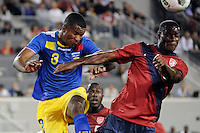 Frickson Erazo (3)  of Ecuador and Maurice Edu (8)  of the United States. The men's national team of the United States (USA) Ecuador (ECU) during an international friendly at Red Bull Arena in Harrison, NJ, on October 11, 2011.