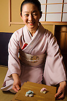 Teamaster Souai Kawada serving wasanbon sweets, Torianchado tea school, Tokyo, Japan, April 5, 2012. Wasanbon is served towards the end of the tea ceremony as an accompaniment to thin tea.