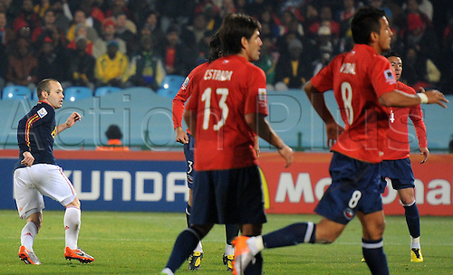 Spain's Andres Iniesta (L) reacts after scoring the 2-0 during the 2010 FIFA World Cup group H match between Chile and Spain at Loftus Versfeld Stadium in Pretoria, South Africa 25 June 2010.  The game ended in a score of Spain 2 Chile 1 and both teams go through to the round of 16.
