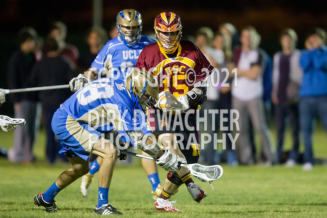 Los Angeles, CA 04/21/10 - Ian Dyckes (UCLA #18) and Trevor Shaffer (USC #15) in action during the cross town rivalry game between USC and UCLA, UCLA defeated USC 10-9 and secured a quarterfinal position in the MCLA-SLC playoff bracket.