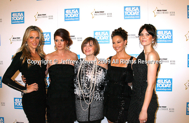 BEVERLY HILLS, CA. - November 10: Molly Sims, Debra Messing, Kate Roberts of PSI, Ashley Judd and Mandy Moore arrive at the USA Today Hollywood Hero Awards at Montage Beverly Hills on November 10, 2009 in Beverly Hills, California.