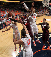 Virginia Tech forward Jarell Eddie (31) is surrounding by Virginia  defenders during the game Tuesday in Charlottesville, VA. Virginia defeated Virginia Tech73-55.