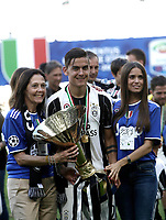 Calcio, Serie A: Juventus vs Crotone. Torino, Juventus Stadium, 21 maggio 2017.<br /> Juventus' Paulo Dybala, flanked by his mother and his girlfriend, holds the trophy during the celebrations for the victory of the sixth consecutive Scudetto at the end of the Italian Serie A football match between Juventus and Crotone at Turin's Juventus Stadium, 21 May 2017. Juventus defeated Crotone 3-0.<br /> UPDATE IMAGES PRESS/Isabella Bonotto