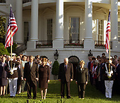 U.S. President George W. Bush, First Lady Laura Bush, Vice President Dick Cheney, Mrs. Lynne Cheney and members of the White House staff bow their heads in prayer to mark the exact moment of the first terrorist attack on the World Trade Center at 8:46 AM two years ago at the White House in Washington, DC on September 11, 2003.<br /> Credit: Ron Sachs / CNP