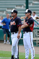 Atlanta Braves Hall of Fame pitcher Tom Glavine, right, watches a workout with manager Fredi Gonzalez prior to a Spring Training game against the New York Yankees on Wednesday, March 18, 2015, at Champion Stadium at the ESPN Wide World of Sports Complex in Lake Buena Vista, Florida. The Yankees won, 12-5. (Tom Priddy/Four Seam Images)