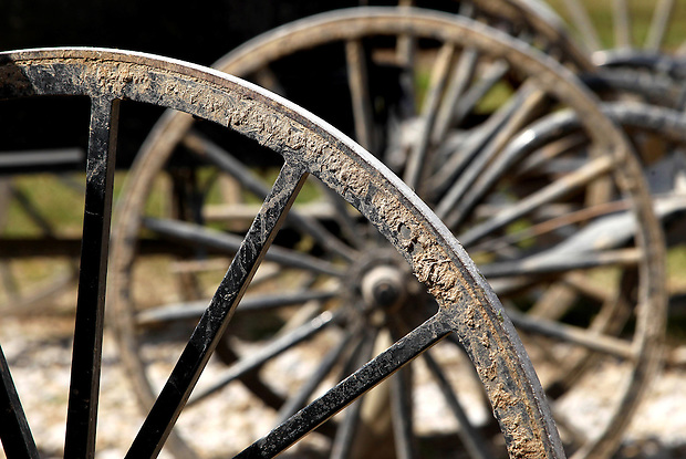 Mud-caked wheels on horse carriages line up outside Brodhead Collar Shop, where horse collars are made by hand near  Drakesville in southeast Iowa's Davis County.  (Christopher Gannon/The Des Moines Register)