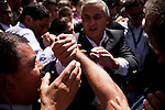 """Presidential candidate Otto Perez Molina shakes hands with supporters at a polling place to make his vote on the day of the Presidential elections, in Guatemala City, Guatemala, on Saturday, Nov. 5, 2011. Molina, a retired military general, won the elections. Fifteen years after the end of its bloody and genocidal civil war, Guatemala elected its first peacetime military leader, a former army general who emerged from military retirement shrouded with human rights abuses. The country that once turned its back on the military, has returned to military power...President Otto Pérez Molina rallied a """"mano dura"""" campaign to fight incessant violence caused by the global drug market, organized crime, and the international financial crisis."""