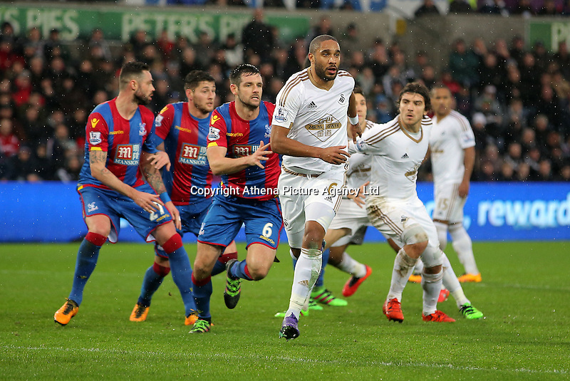 Ashley Williams of Swansea (C) run forward to get the ball from a corner kick during the Barclays Premier League match between Swansea City and Crystal Palace at the Liberty Stadium, Swansea on February 06 2016