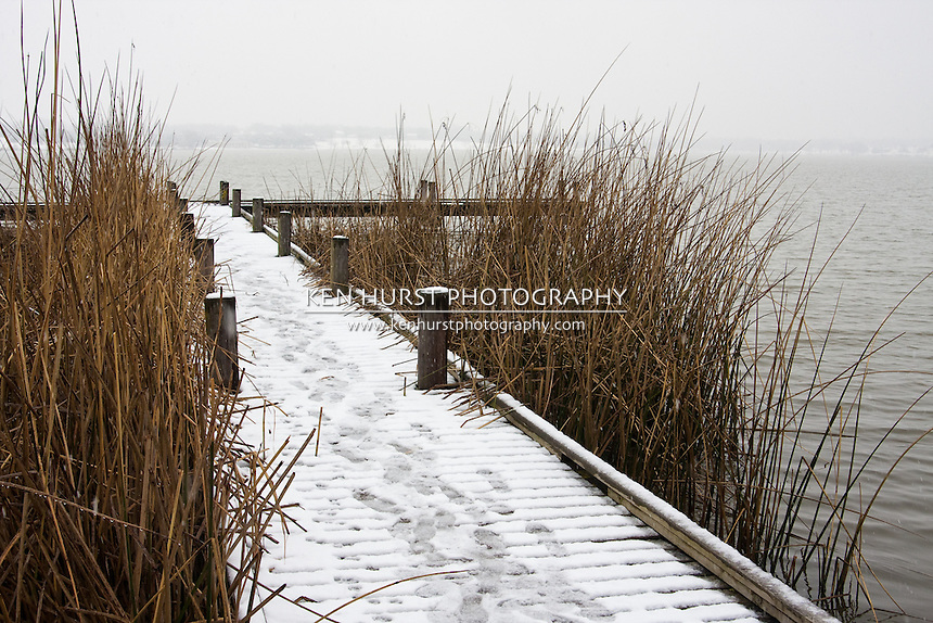 Footprints in the snow on a pier on White Rock Lake in Dallas, Texas during a rare winter snowfall in February 2010.