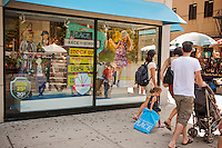 A back to school window display is seen at one of The Children's Place stores in Union Square in New York on Saturday, August 4, 2012. Stores are beginning to offer earlier than usual back to school specials. (© Richard B. Levine)