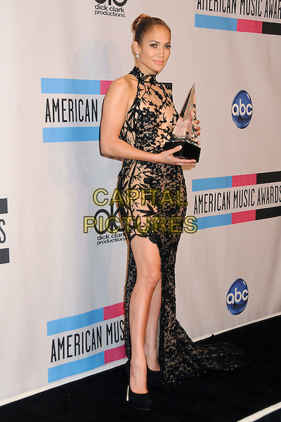 Jennifer Lopez.2011 American Music Awards - Press Room held at Nokia Theatre LA Live, Los Angeles, California, USA..November 20th, 2011.ama amas ama's full length black dress sheer lace one sleeve train sleeveless trophy winner slit split .CAP/ADM/BP.©Byron Purvis/AdMedia/Capital Pictures.