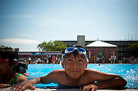 The popular McCarren Pool in Williamsburg, Brooklyn in New York reopens after a being closed since 1984, seen on the opening day of the city pools in New York on Thursday, June 28, 2012. The pool, built in 1936, opened the outdoor pool season in New York after its multi-million dollar renovation. The enormous swimming pool can hold 1500 bathers and will likely become the go to place for the hipsters of Williamsburg.  (© Richard B. Levine)