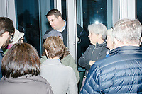 A campaign volunteer tells people they won't be let in due to capacity issues before Democratic presidential candidate Pete Buttigieg arrives to speak at a campaign event at the Currier Museum of Art in Manchester, New Hampshire, USA, on Fri., Apr. 5, 2019. The venue was filled to capacity about an hour before the candidate's arrival, so Buttigieg delivered an impromptu speech to those denied entry outside the museum before the official event. Buttigieg is the mayor of South Bend, Indiana, and was widely considered a long-shot candidate until his appearance in a CNN town hall in March 2019 which catapulted his campaign to prominence and substantial donations.
