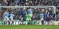 Manchester City's Aymeric Laporte with a header towards goal<br /> <br /> Photographer Rob Newell/CameraSport<br /> <br /> The Carabao Cup Final - Chelsea v Manchester City - Sunday 24th February 2019 - Wembley Stadium - London<br />  <br /> World Copyright © 2018 CameraSport. All rights reserved. 43 Linden Ave. Countesthorpe. Leicester. England. LE8 5PG - Tel: +44 (0) 116 277 4147 - admin@camerasport.com - www.camerasport.com