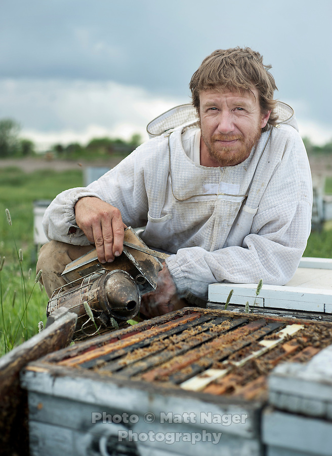 Bee keeper for Grampa's Gourmet Brent Edelen (cq) in his field near Alamosa, Colorado, June 1, 2012. Bee keeping has been in Edelen's family for over six generations, originating in Switzerland...Photo by MATT NAGER