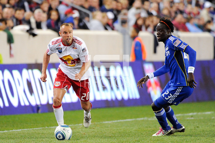 Joel Lindpere (20) of the New York Red Bulls is defended by Kei Kamara (23) of the Kansas City Wizards. The New York Red Bulls defeated the Kansas City Wizards 1-0 during a Major League Soccer (MLS) match at Red Bull Arena in Harrison, NJ, on October 02, 2010.