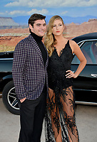 "LOS ANGELES, USA. October 08, 2019: RJ Mitte and Guest at the premiere of ""El Camino: A Breaking Bad Movie"" at the Regency Village Theatre.<br /> Picture: Paul Smith/Featureflash"
