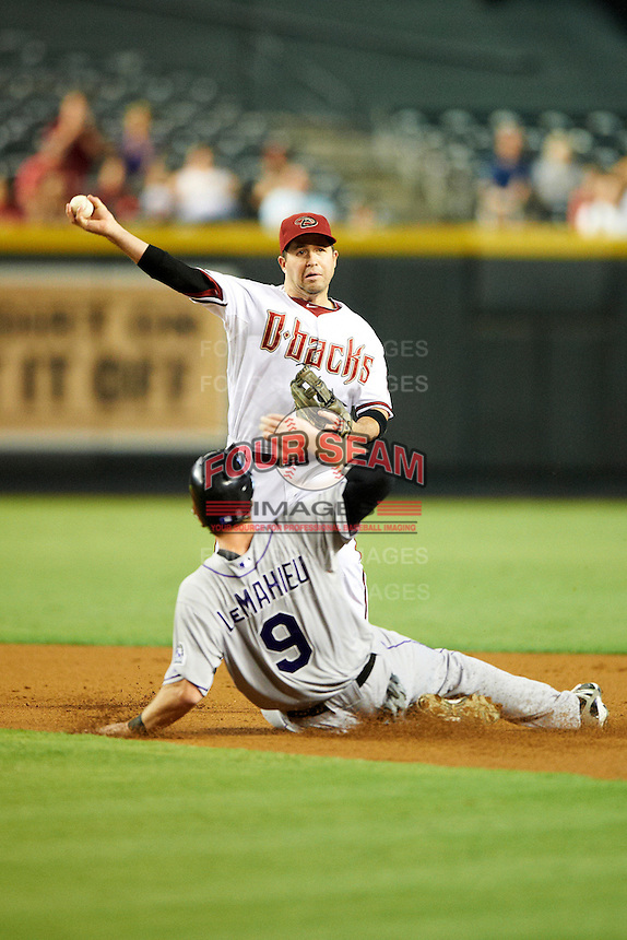 Arizona Diamondbacks shortstop John McDonald #16 attempts to turn a double play as D.J. LeMahieu #9 slides in during a National League regular season game against the Colorado Rockies at Chase Field on October 2, 2012 in Phoenix, Arizona. Arizona defeated Colorado 5-3. (Mike Janes/Four Seam Images)