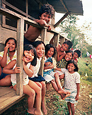 PANAMA, Bocas del Toro, Salt Creek Islands, a group of Guaymi Indian children gather and laugh in front of a house, Central America