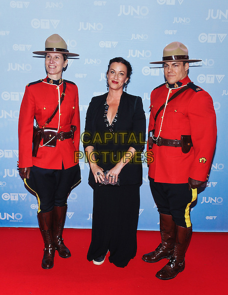 15 March 2015 - Hamilton, Ontario, Canada.  Alanis Morissette poses on the red carpet during the 2015 JUNO Awards at FirstOntario Centre. <br /> CAP/ADM/BPC<br /> &copy;Brent Perniac/AdMedia/Capital Pictures
