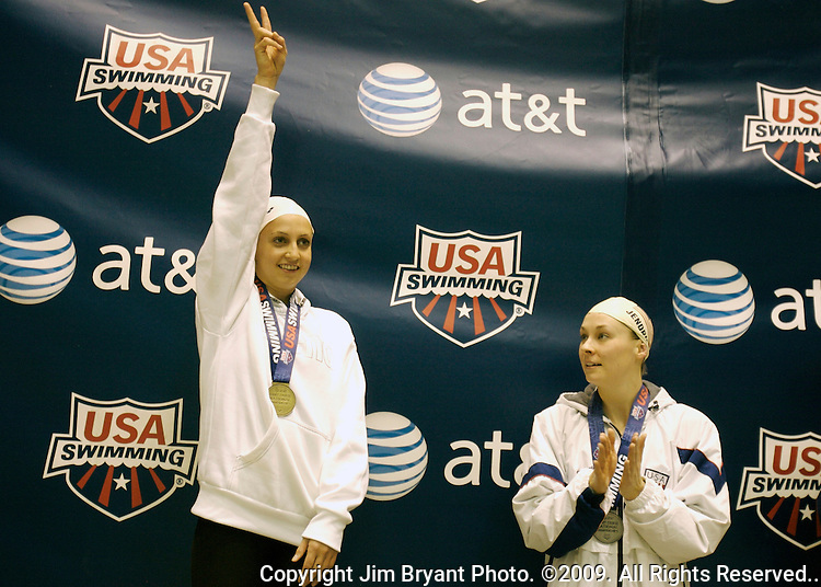 Rebecca Soni, right, waves after receiving the gold medal in the women's 100-yard breaststroke event at the AT & T Short Course National Short Course Swimming Championships on December 3rd to the 5th, 2009., in Federal Way,  Washington. Soni placed first with a time of 58.62, while Megan Jendrick took second with 59.26. Jim Bryant Photo. ©2009. All Rights Reserved...