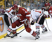 Brendan Rempel (Harvard - 42), Chris Donovan (NU - 23), Steve Morra (NU - 12), Luke Greiner (Harvard - 24) - The Northeastern University Huskies defeated the Harvard University Crimson 4-1 (EN) on Monday, February 8, 2010, at the TD Garden in Boston, Massachusetts, in the 2010 Beanpot consolation game.