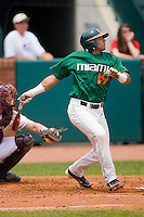 Frankie Ratcliff #19 of the Miami Hurricanes follows through on his swing against the Boston College Eagles at the 2010 ACC Baseball Tournament at NewBridge Bank Park May 27, 2010, in Greensboro, North Carolina.  The Eagles defeated the Hurricanes 12-10 in 10 innings.  Photo by Brian Westerholt / Four Seam Images