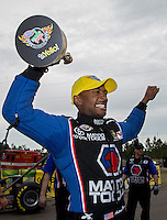 Mar. 17, 2013; Gainesville, FL, USA; NHRA top fuel dragster driver Antron Brown celebrates after winning the Gatornationals at Auto-Plus Raceway at Gainesville. Mandatory Credit: Mark J. Rebilas-