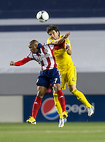 CARSON, CA - March 2, 2013: Chivas forward Tristan Bowen (7) and Columbus defender Glauber (4) during the Chivas USA vs Columbus Crew match at the Home Depot Center in Carson, California. Final score, Chivas USA 0, Columbus Crew 3.