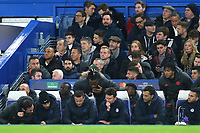 Chelsea Manager, Frank Lampard and his coaching team together with the substitutes seem to be looking at a replay of Ajax's third goal during Chelsea vs AFC Ajax, UEFA Champions League Football at Stamford Bridge on 5th November 2019