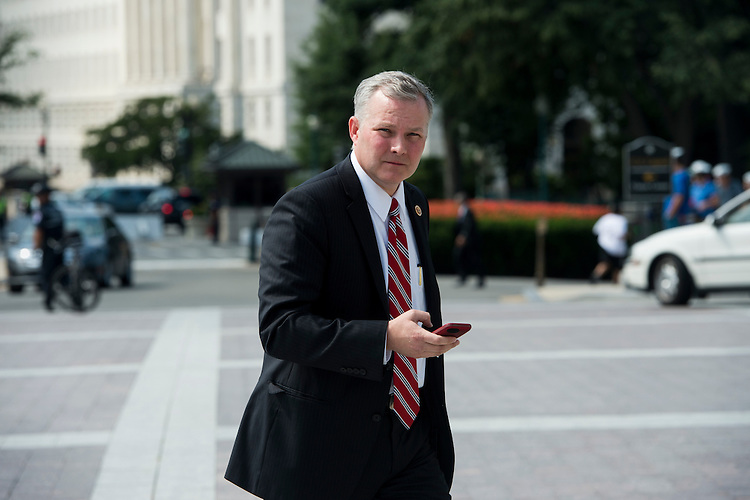 UNITED STATES - JULY 11: Rep. Tim Griffin, R-Ark., walks to the Capitol for a vote on Friday, July 11, 2014. (Photo By Bill Clark/CQ Roll Call)