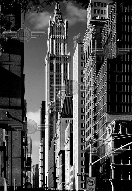 The Woolworth Building in downtown Manhattan, along Broadway. The Woolworth Building, designed by architect Cass Gilbert and completed in 1913, is one of the oldest skyscrapers in the United States. It has been described as a 'Cathedral of Capiltalism'.<br />  High res scans available.