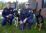 State Trooper James O'Donnell, left, and his dog Arek and State Trooper Kevin Eklund and his dog Magnum, outside of Troop C in Tolland Wednesday. A Jim Michaud pic 4/5/06
