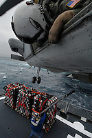 "070717-N-7981E-272 Pacific Ocean (July 17, 2007)-Aviation Warfare Systems Operator 2nd Class Tyler Yee of Helicopter Anti-submarine Squadron (HS) 2 ""Golden Falcons"" relays information to the pilots of an HH-60H Seahawk as crewmembers aboard the fleet replenishment oiler USNS Henry J. Kaiser (T-AO 187) attach cargo to the underside of the helicopter during a Vertical Replenishment (VERTREP) and Fueling At Sea (FAS) between Kaiser and the Nimitz-class aircraft carrier USS Abraham Lincoln (CVN-72). Lincoln is currently underway conducting Carrier Qualifications as part of a scheduled work-up off the coast of Southern California. U.S. Navy photo by Mass Communications Specialist 3rd Class James R. Evans (RELEASED)"