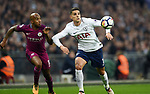 Erik Lamela of Tottenham Hotspur is challenged by Fabian Delph of Manchester City during the premier league match at the Wembley Stadium, London. Picture date 14th April 2018. Picture credit should read: Robin Parker/Sportimage
