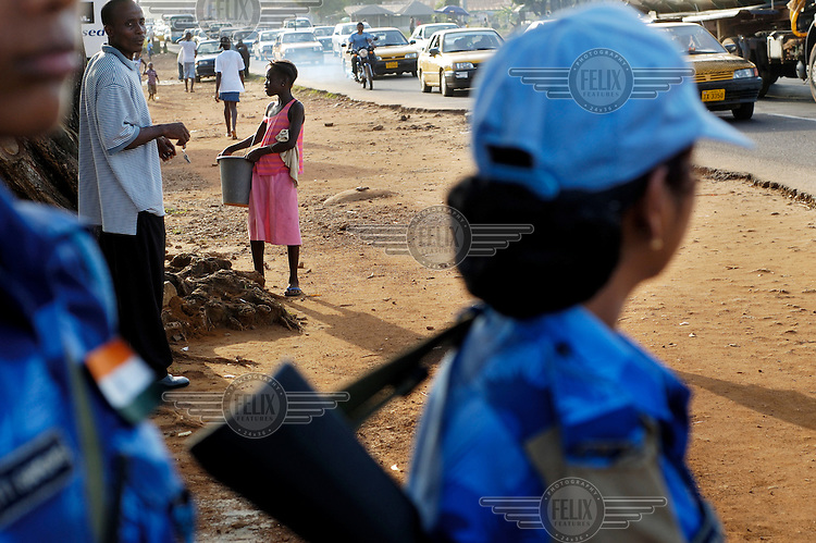 LIBERIA, 09/04/2007..Vaishali scans the street and passing cars whilst on a Joint Task Force patrol in the Duport Road area of Monrovia...© 2007 Aubrey Wade. All rights reserved...