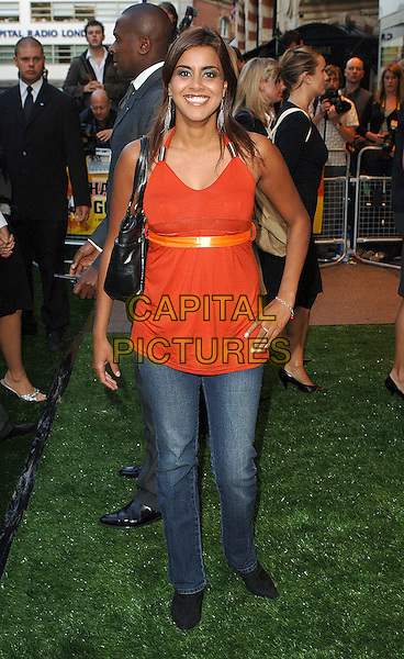 "POOJA SHAH.Attending the World Charity Premiere of ""In The Hands Of The Gods"", Odeon West End, London, England..September 10th, 2007. full length orange top jeans denim.CAP/ BEL.©Tom Belcher/Capital Pictures."