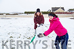 Juliette and Sophie Lynch making a snowman in Ballydonoghue on Friday.