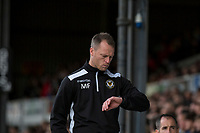 Newport County manager Mike Flynn checks his watch during the Sky Bet League 2 match between Newport County and Notts County at Rodney Parade, Newport, Wales on 6 May 2017. Photo by Mark  Hawkins / PRiME Media Images.