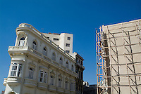 Colonial architecture next to a new building still under construction in Havana, Cuba.
