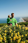 California wildflower travel: Family with yellow bush lupine at Point Reyes..Photo copyright Lee Foster.  Photo # cawild102296