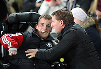 SWANSEA, WALES - MARCH 16: Liverpool manager Brendan Rodgers (R) greets a young disabled Swansea fan prior to the Premier League match between Swansea City and Liverpool at the Liberty Stadium on March 16, 2015 in Swansea, Wales